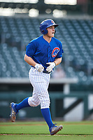 AZL Cubs 1 Ethan Hearn (9) jogs to first base after drawing a walk during an Arizona League game against the AZL D-backs on July 25, 2019 at Sloan Park in Mesa, Arizona. The AZL D-backs defeated the AZL Cubs 1 3-2. (Zachary Lucy/Four Seam Images)