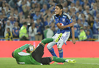 BOGOTA - COLOMBIA -21 -05-2015: Kevin Rendon (Der) jugador de Millonarios disputa el balón con Breiner Castillo (Izq) arquero de Envigado FC durante partido de ida por los cuartos de final de la Liga Águila I 2015 jugado en el estadio Nemesio Camacho El Campín de la ciudad de Bogotá./ Kevin Rendon (R) player of Millonarios fights for the ball with Breiner Castillo (L) goalkeeper of Envigado FC during the first leg match for the final quarters of the Aguila League I 2015 played at Nemesio Camacho El Campin stadium in Bogotá city. Photo: VizzorImage / Gabriel Aponte / Staff.