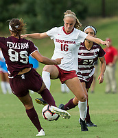 Hawgs Illustrated/BEN GOFF <br /> Emily Russell (16) of Arkansas vs Brina Alston (99) and Jordan Hill of Texas A&M in the first half Thursday, Sept. 20, 2018, at Razorback Field in Fayetteville.