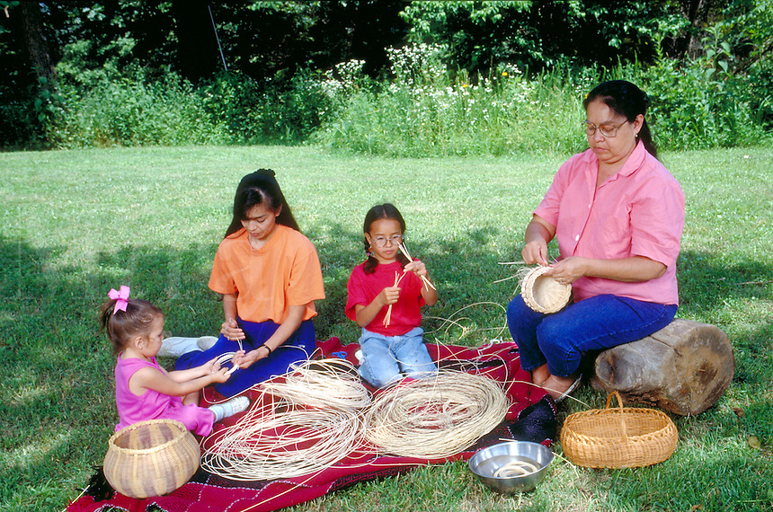 Three generations of Cherokee women doing basketry at home.  Tahlequah, OK