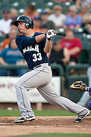 New Orleans Zephyrs third baseman Matt Dominquez #33 swings during the Pacific Coast League baseball game against the Round Rock Express on April 30, 2012 at The Dell Diamond in Round Rock, Texas. The Zephyrs defeated the Express 5-3. (Andrew Woolley / Four Seam Images).