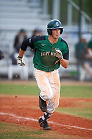 Dartmouth Big Green shortstop Nate Ostmo (19) runs to first base during a game against the Southern Maine Huskies on March 23, 2017 at Lake Myrtle Park in Auburndale, Florida.  Dartmouth defeated Southern Maine 9-1.  (Mike Janes/Four Seam Images)