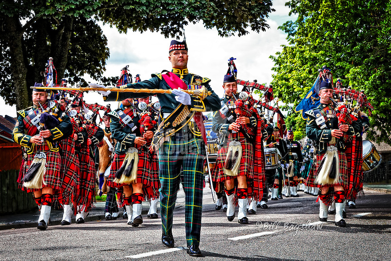 Royal Guard at Ballater. The Queen's Royal Guard enters Ballater Highland Games. <br /> Although The Royal Guard is a ceremonial guard featuring a pipe band and a sword bearer it also includes troops armed with machine guns. www.dsider.co.uk dsider online magazine,whats on Ballater. Copyright Bill Bagshaw photography courses & commercial photographers.