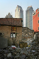 CHINA. Shanghai. Partially destroyed homes lie near modern developments in the centre of Shanghai. Shanghai is a sprawling metropolis or 15 million people situated in south-east China. It is regarded as the country's showcase in development and modernity in modern China. This rapid development and modernization, never seen before on such a scale has however spawned countless environmental and social problems. 2008.