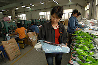 Line manager, Cheng Ping, at Shenzhen Deluxe Plastics factory, Shenzhen, China. The comapny makes plastic bags for several clients including some european clients.<br /> <br /> Photo by Richard Jones / Sinopix