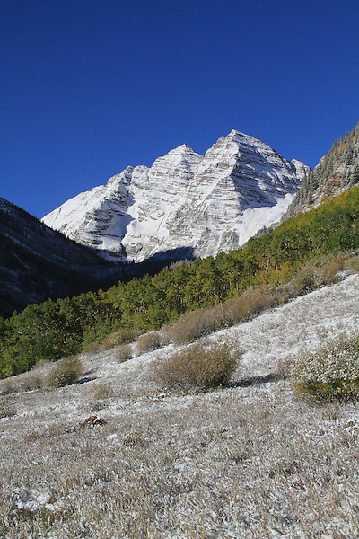 Autumn snow and the Maroon Bells Peaks, Aspen, Colorado John offers fall foliage photo tours throughout Colorado. .  John leads private photo tours in Boulder and throughout Colorado. Year-round Boulder photo tours.