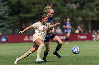 NEWTON, MA - SEPTEMBER 12: Mia Karras #24 of Boston College brings the ball forward as Colleen McIlvenna #22 of Holy Cross pressures during a game between Holy Cross and Boston College at Newton Campus Soccer Field on September 12, 2021 in Newton, Massachusetts.