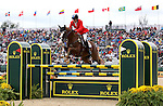 Boyd Martin and Neville Bardos of the USA compete in the final stadium jumping round of the FEI  World Eventing Championship at the Alltech World Equestrian Games in Lexington, Kentucky.