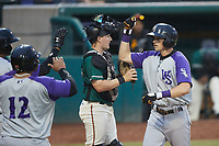 Duke Ellis (11) of the Winston-Salem Dash is greeted by teammates at home plater after hitting a home run against the Greensboro Grasshoppers at First National Bank Field on June 3, 2021 in Greensboro, North Carolina. (Brian Westerholt/Four Seam Images)