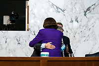 United States Senator Lindsey Graham (Republican of South  Carolina), Chairman, US Senate Judiciary Committee and United States Senator Dianne Feinstein (Democrat of California), Ranking Member, US Senate Judiciary Committee, hug at the conclusion of the fourth day of the confirmation hearing for Judge Amy Coney Barrett, President Donald Trump's Nominee for Supreme Court, in Hart Senate Office Building in Washington DC, on October 15th, 2020.<br /> Credit: Anna Moneymaker / Pool via CNP /MediaPunch