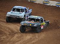 Mar. 20, 2011; Chandler, AZ, USA;  LOORRS pro four driver Todd Leduc leads Travis Coyne during round two at Firebird International Raceway. Mandatory Credit: Mark J. Rebilas-