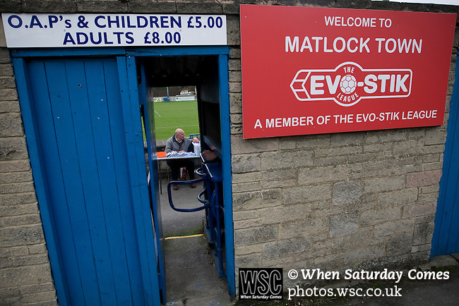 Matlock Town 0 Eastwood Town 3, 09/10/2010. Causeway Lane, FA Cup 3rd qualifying round. A programme seller waits for spectators to enter the ground before the FA Cup 3rd qualifying round tie between Matlock Town and Eastwood Town at Causeway Lane, Matlock. The visitors from Nottingham who play one division higher than Matlock won by three goals to nil to move to within one round of the FA Cup 1st round proper. The match was watched by 655 spectators. Photo by Colin McPherson.