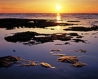 Sunrise light on the rocky shore of Lake Michigan at Cana Island; Door County, WI