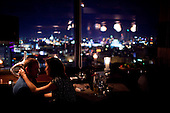Moscow, Russia<br /> September 18, 2009<br /> <br /> A Russian couple at the Kalina Bar that overlooks Moscow city and is a very popular spot for the rich and famous to dine prior to going out clubbing and dancing elsewhere.