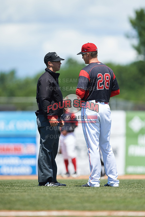 Batavia Muckdogs manager Mike Jacobs (28) questions a call with base umpire Ben Rosen during a game against the West Virginia Black Bears on June 25, 2017 at Dwyer Stadium in Batavia, New York.  West Virginia defeated Batavia 6-4 in the completion of the game started on June 24th.  (Mike Janes/Four Seam Images)