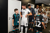 Matt Grimes of Swansea City interacts with a young Swansea mascot during the Sky Bet Championship match between Swansea City and Nottingham Forest at the Liberty Stadium in Swansea, Wales, UK. Saturday 14 September 2019