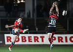 Fly-half Ian Keatley of Munster Rugby kicks the ball past Fly half Dorian Jones of Newport Gwent Dragons.<br /> <br /> Guinness Pro 12<br /> Newport Gwent Dragons v Munster Rugby<br /> Rodney Parade<br /> 21.11.14<br /> ©Steve Pope-SPORTINGWALES