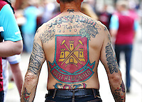 A West Ham fans with West Ham United crest tattooed on his shoulders   during the Barclays Premier League match between West Ham United and Swansea City  played at Boleyn Ground , London on 7th May 2016