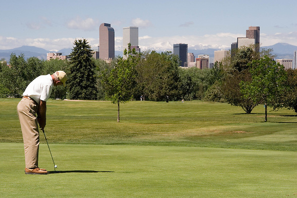 Senior citizen putting in City Park Golf Course, Denver, Colorado. .  John offers private photo tours in Denver, Boulder and throughout Colorado. Year-round Colorado photo tours.