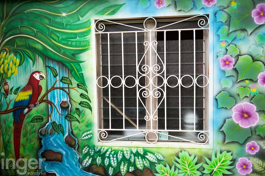 Brightly coloured building and window near La Ceiba, Honduras