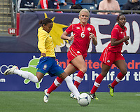 Brazilian player Danilelle Silva (20) passes the ball as Canadian player Kaylyn Kyle (6) closes. In an international friendly, Canada defeated Brasil, 2-1, at Gillette Stadium on March 24, 2012.
