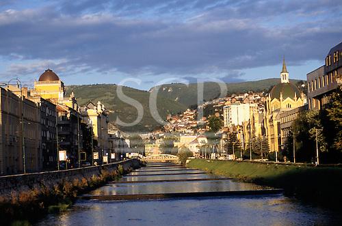 Sarajevo, Bosnia and Herzegovina. View of the city; buildings by the river Miljacka.