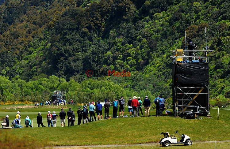 Fans watch play at the 4th green on day one of the 2017 Asia-Pacific Amateur Championship day one at Royal Wellington Golf Club in Wellington, New Zealand on Thursday, 26 October 2017. Photo: Dave Lintott / lintottphoto.co.nz