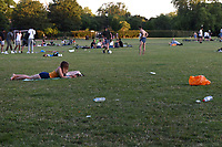 Member of the public enjoy the warm weather at Primrose Hill during the coronavirus pandemic