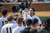 Will Craig (22) of the Wake Forest Demon Deacons is congratulated by his teammates after leading off the bottom of the 2nd inning with a home run against the Miami Hurricanes at Wake Forest Baseball Park on March 21, 2015 in Winston-Salem, North Carolina.  The Hurricanes defeated the Demon Deacons 12-7.  (Brian Westerholt/Four Seam Images)