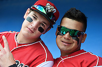 Batavia Muckdogs outfielder Ryan Aper (3) and catcher Rodrigo Vigil (27) in the dugout before a game against the Mahoning Valley Scrappers on August 24, 2014 at Dwyer Stadium in Batavia, New York.  Mahoning Valley defeated Batavia 7-6.  (Mike Janes/Four Seam Images)
