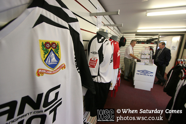 Replica shirts on display at the small club shop at Morecambe Football Club. The club was preparing for the club's first-ever season in the Football League having been promoted from the Conference the previous season.  Photo by Colin McPherson.