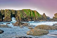 Rocks, moon, low tide and wave at Bandon beach. Oregon