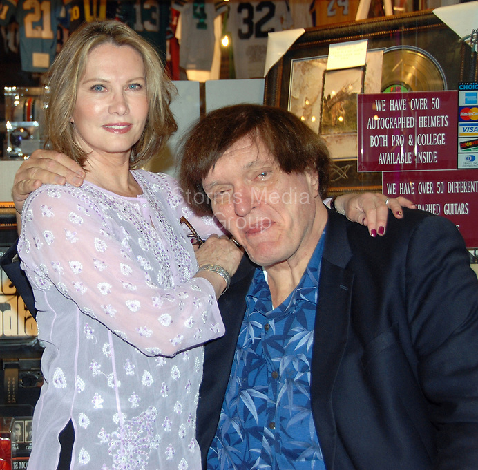 """LAS VEGAS - NOVEMBER 30: Richard """" Jawz""""  Kiel (The Spy Who Loved Me, Moonraker) and Maud Adams (The Man with The Golden Gun, Octopussy)  at the Gallery of Legends memorabilia store in the mall adjoining the Planet Hollywood Hotel & Casino.  on November 29, 2008 in Las Vegas, Nevada. <br /> <br /> <br /> People:  Richard Kiel, Maud Adams"""