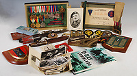 BNPS.co.uk (01202 558833)<br /> Pic: LindsayBurns/BNPS<br /> <br /> The medals, weapons and personal effects of a hero D-Day commando have sold for over £11,000 - 22 times their estimate.<br /> <br /> Marine Jock Mathieson narrowly escaped death during the Normandy landings on June 6, 1944.<br /> <br /> A bullet pierced the fuel tank of his motorbike which he was carrying above his head while wading through the sea towards Juno Beach.