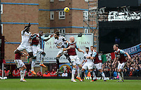 Pictured L-R: Battle for a header between Wilfried Bony of Swansea, Guy Demel of West Ham, Chico Flores of Swansea and James Collins of West Ham.  01 February 2014<br /> Re: Barclay's Premier League, West Ham United v Swansea City FC at Boleyn Ground, London.