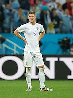 Gary Cahill of England looks dejected