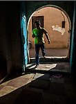 TRIPOLI, LIBYA — <br /> <br /> A man walks through the door of the souk in Tripoli's old city. Life in Tripoli goes on as normal as possible. After sunset, gun fire from local criminal groups can be heard as a state of lawlessness takes over the relative calm that is daylight hours.