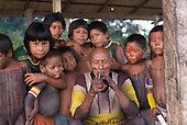 Pará State, Brazil. Aldeia Pukararankre (Kayapo). Cacique Kadjunhoro Kayapo with the village children.