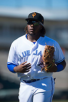 Surprise Saguaros third baseman Vladimir Guerrero Jr. (27), of the Toronto Blue Jays organization, jogs off the field between innings of an Arizona Fall League game against the Salt River Rafters on October 9, 2018 at Surprise Stadium in Surprise, Arizona. The Rafters defeated the Saguaros 10-8. (Zachary Lucy/Four Seam Images)