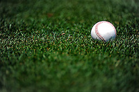 10 July 2011: A baseball lies on the turf during batting practice prior to a game between the Colorado Rockies and the Washington Nationals at Nationals Park in Washington, District of Columbia. The Nationals shut out the visiting Rockies 2-0 to salvage the last game their 3-game series prior to the All-Star break. Mandatory Credit: Ed Wolfstein Photo