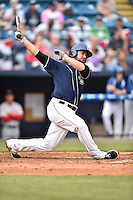 Asheville Tourists first baseman Sean Dwyer (27) swings at a pitch during game one of a double header against the Greenville Drive on April 18, 2015 in Asheville, North Carolina. The Tourists defeated the Drive 2-1. (Tony Farlow/Four Seam Images)