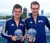10 SEP 2011 - BEIJING, CHN - Alistair Brownlee (GBR) (right) shows off his trophy for winning the 2011 Elite Mens ITU World Championship Series title with a victory in the Grand Final in a time of 1:48:06. His brother Jonathan Brownlee (GBR) (left) took second place after coming third in the Grand Final (PHOTO (C) NIGEL FARROW)