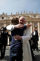 Papa Francesco abbraccia un bambino al termine dell'udienza generale del mercoledi' in Piazza San Pietro, Citta' del Vaticano, 6 aprile 2016.<br /> Pope Francis embraces a child at the end of his weekly general audience in St. Peter's Square at the Vatican, 6 April 2016.<br /> UPDATE IMAGES PRESS/Isabella Bonotto<br /> <br /> STRICTLY ONLY FOR EDITORIAL USE