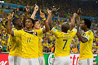 James Rodriguez of Columbia celebrates scoring a goal with team mates after making it 2-0