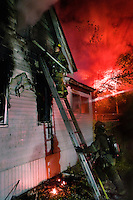 """Firefighters battle a blaze at a house in Detroit, Michigan. During the days surrounding Halloween of 2008 there were around 100 arson attacks in the city. This is much higher than the yearly average, but nothing like the infamous """"Devil Nights"""" of the 1980s. In 1984, nearly 800 fires were started in the three days around Halloween."""