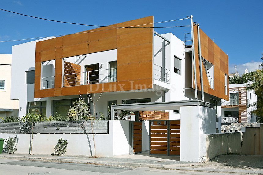 The modern house of 300 sq.m. in Athens, with three different levels, serves the needs of the family offering them a comfortable life.