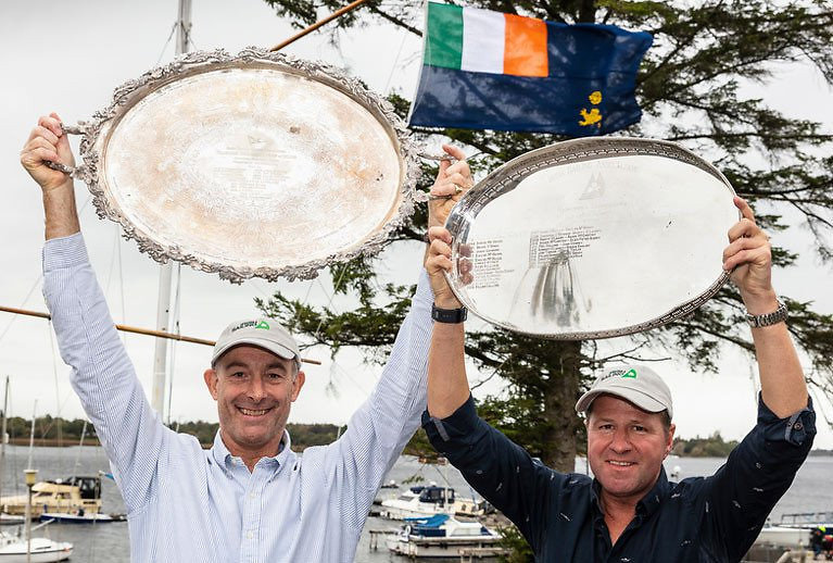 When time stands still - 2018 winner Peter Kennedy of Strangford Lough YC and teammate Stephen Kane hold their trophies in the air after winning the SB20s at Lough Ree YC.