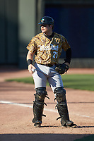 Down East Wood Ducks catcher Matt Whatley (20) warms up in the outfield prior to the game against the Winston-Salem Dash at BB&T Ballpark on May 12, 2018 in Winston-Salem, North Carolina. The Wood Ducks defeated the Dash 7-5. (Brian Westerholt/Four Seam Images)