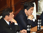 December 24, 2014, Tokyo, Japan - Prime Minister Shinzo Abe, right, waits for the outcome of a parliamentary process to elect Japan's new leader during a special Diet session convened in Tokyo on Wednesday, December 24, 2014. Abe was re-elected as prime minister and set to form a new Cabinet. (Photo by Natsuki Sakai/AFLO)
