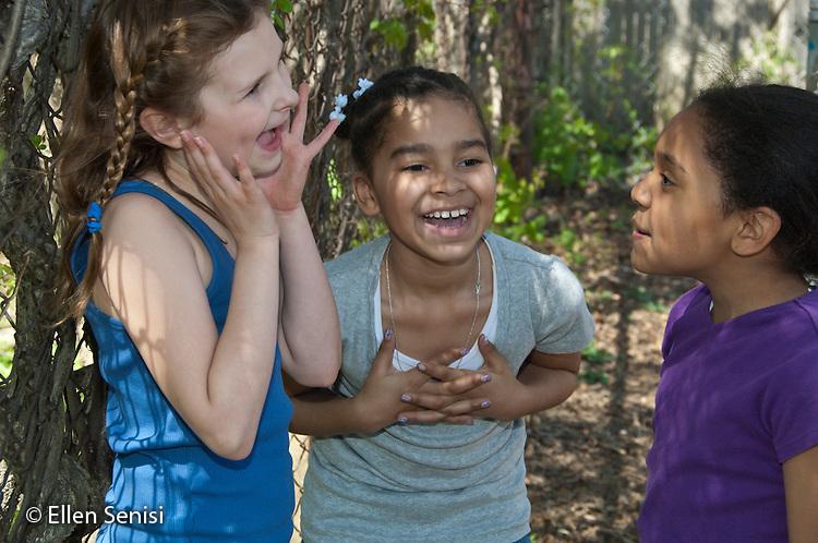 MR / Schenectady, NY. Elmer Avenue School (urban public elementary school). 3rd Grade. Girls laugh and socialize outside. Girls (left: 8; middle: 8, African American; right: 8, African American & Puerto-Rican American). MR: Mit10, Dou1, Fra6. ID: AH-FRD. © Ellen Senisi